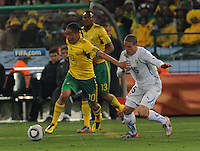South African midfielder looks to get some separation from Diego Perez and build an attack towards the Uruguaian goal. Uruguay defeated South Africa, 2-0, in both teams' second match of play in Group A of the 2010 FIFA World Cup. The match was played at Loftus Versfeld in Pretoria, South Africa June 16th.