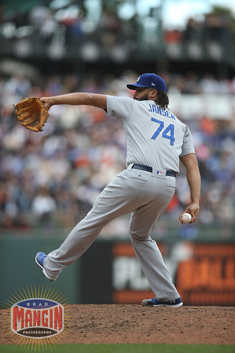 SAN FRANCISCO, CA - SEPTEMBER 29:  Kenley Jansen #74 of the Los Angeles Dodgers pitches against the San Francisco Giants during the game at AT&T Park on Saturday, September  29, 2018 in San Francisco, California. (Photo by Brad Mangin)