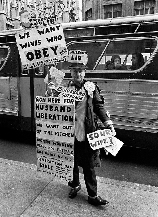 Harry Britton, a career protestor, stands near Rockefeller Center in New York City in 1973. Britton left his wife and family in Erie, PA after he was laid off from his job and his wife got a job. He told her she could not work and if she did he would leave. She needed to support the family so would not quit, he left and did this the rest of hisdays.