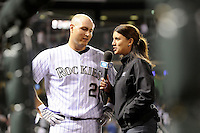 14 April 2010: Colorado Rockies catcher Chris Iannetta (20) is interviewed by Fox Sports Network Rocky Mountain reporter Alanna Rizzo after he hit the go-ahead walk-off leadoff homerun in the bottom of the 10th inning during a regular season Major League Baseball game between the Colorado Rockies and the New York Mets at Coors Field in Denver,  Colorado. The Rockies defeated the Mets 6-5 in 10 innings.  *****For Editorial Use Only*****