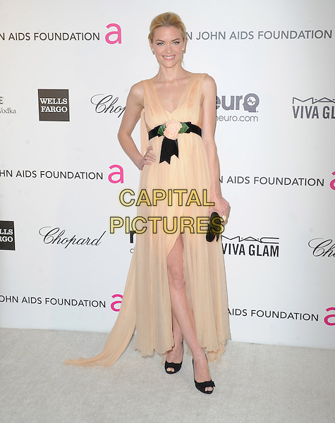 Jaime King.The 21st Annual Elton John AIDS Foundation Academy Awards Viewing Party held at The City of West Hollywood Park in West Hollywood, California, USA..February 24th, 2013.oscars full length orange pink peach dress black waistband clutch bag sheet sleeveless slit split hand on hip.CAP/DVS.©DVS/Capital Pictures.