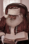 Santa Claus reading a large book