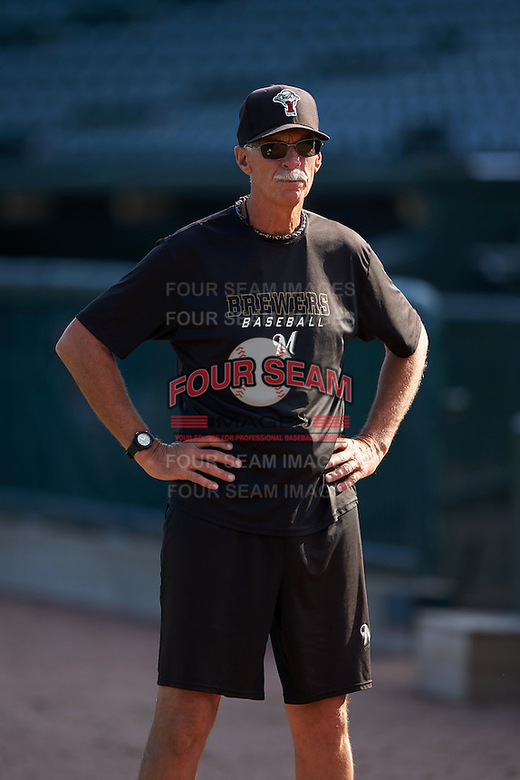 Wisconsin Timber Rattlers pitching coach Gary Lucas (25) during practice before a game against the Peoria Chiefs on August 21, 2015 at Dozer Park in Peoria, Illinois.  Wisconsin defeated Peoria 2-1.  (Mike Janes/Four Seam Images)