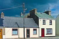 Street scene pastel painted terraced homes in Kilkee, County Clare, West of Ireland