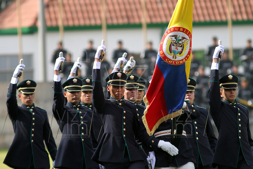 BOGOTA -COLOMBIA- 06 -11--2013. Ceremonia de conmemoracion de los 122 años de fundacion de la Policía Nacional de Colombia y la graduación y desfile de 273 como subtenientes en La Escuela de Cadetes de Policía General Santander. Al acto asistireon el presidente de la Republica de Colombia, Juan Manuel Santos , el director de la Policia Nacional, General Rodolfo Palomino Palomino, el ministro de defensa nacional, Juan Carlos Pinzon y toda la cúpula militar./ Commemoration ceremony of the 122 years of foundation of National Police of Colombia and graduation and parade of 275 members as a second lieutenants at Escuela de Cadetes de Policia General Santander in Bogotcity, Colombia. The event was attended by Juan Manuel Santos President of Colombia, General Rodolfo Palomino National Police Chief, Juan Carlos Pinzon Defense minister and the entire military leadership.  Photo: VizzorImage / Felipe Caicedol / Staff