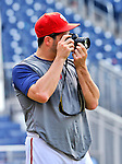 19 June 2011: Washington Nationals' pitcher Jason Marquis takes some photos after a Father's Day game against the Baltimore Orioles at Nationals Park in Washington, District of Columbia. The Orioles defeated the Nationals 7-4 in inter-league play, and ended Washington's 8-game winning streak. Mandatory Credit: Ed Wolfstein Photo