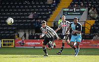 Rowan Liburd (Loanee from Reading) of Wycombe Wanderers and Wes Atkinson of Notts County chase down the ball during the Sky Bet League 2 match between Notts County and Wycombe Wanderers at Meadow Lane, Nottingham, England on 28 March 2016. Photo by Andy Rowland.