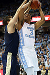 14 February 2016: North Carolina's Kennedy Meeks (3) and Pittsburgh's Rafael Maia (BRA) (left). The University of North Carolina Tar Heels hosted the University of Pittsburgh Panthers at the Dean E. Smith Center in Chapel Hill, North Carolina in a 2015-16 NCAA Division I Men's Basketball game. UNC won the game 85-64.