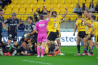 The Hurricanes celebrate winning a defensive penalty during the Super Rugby match between the Hurricanes and Sharks at Westpac Stadium, Wellington, New Zealand on Saturday, 9 May 2015. Photo: Dave Lintott / lintottphoto.co.nz