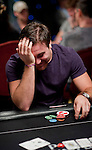 Aaron Gustavson react to seeing his pocket king are behind.