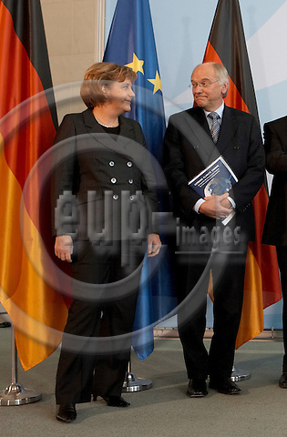 """BERLIN - GERMANY 01. DECEMBER 2006 -- Vatenfalls CEO Lars G. Joseffson (right) is advising the german chancellors Angela Merkel (left) on climate changes -- PHOTO: CHRISTIAN T. JOERGENSEN / EUP & IMAGES..This image is delivered according to terms set out in """"Terms - Prices & Terms"""". (Please see www.eup-images.com for more details)"""