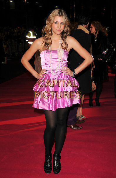 "JEMMA McKENZIE BROWN .UK Premiere of ""Confessions of a Shopaholic"" at the Empire Cinema, Leicester Square, London, .February 16th 2009.full length black tights pink strapless tiered dress hands on hips .CAP/CAS.©Bob Cass/Capital Pictures"