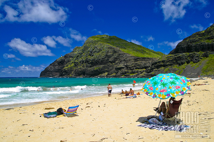 The warm sands,blue waters and colorful umbrellas of scenic Makapuu Beach located along Oahu's eastern coastline.