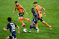 29th July 2020; Bankwest Stadium, Parramatta, New South Wales, Australia; A League Football, Melbourne Victory versus Brisbane Roar; Elvis Kamsoba of Melbourne Victory runs with the ball as Matthew Ridenton of Brisbane Roar gives chase