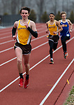 THOMASTON,  CT-040919JS05- Thomaston's Jack McMahon took the early lead in the 1600 meter run and never looked back, winning the event, during their Berkshire League meet with Housatonic Tuesday at Nystrom's Sports Complex in Thomaston.<br /> Jim Shannon Republican American