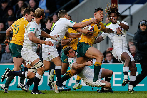 03.12.2016. Twickenham, London, England. Autumn International Rugby. England versus Australia.  Israel Folau of Australia hands off Marlon Yarde as George Ford of England makes the tackle.   Final score: England 37-21 Australia.