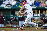 Indiana Hoosiers first baseman Sam Travis (6) swings the bat against the Mississippi State Bulldogs during Game 6 of the 2013 Men's College World Series on June 17, 2013 at TD Ameritrade Park in Omaha, Nebraska. The Bulldogs defeated Hoosiers 5-4. (Andrew Woolley/Four Seam Images)