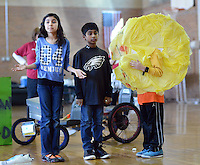 SODYSSEY28P<br /> From left, Heeya Jagirdar and Thomas Cherian of Afton Elementary School interact with PacMan played by Alex Kirk as they demonstrate their solution to No-Cycle Recycle during the Southeast Pennsylvania Odyssey of the Mind tournament Saturday February 27, 2016 at Pennsbury High School West in Fairless Hills, Pennsylvania. (William Thomas Cain/For The Inquirer)