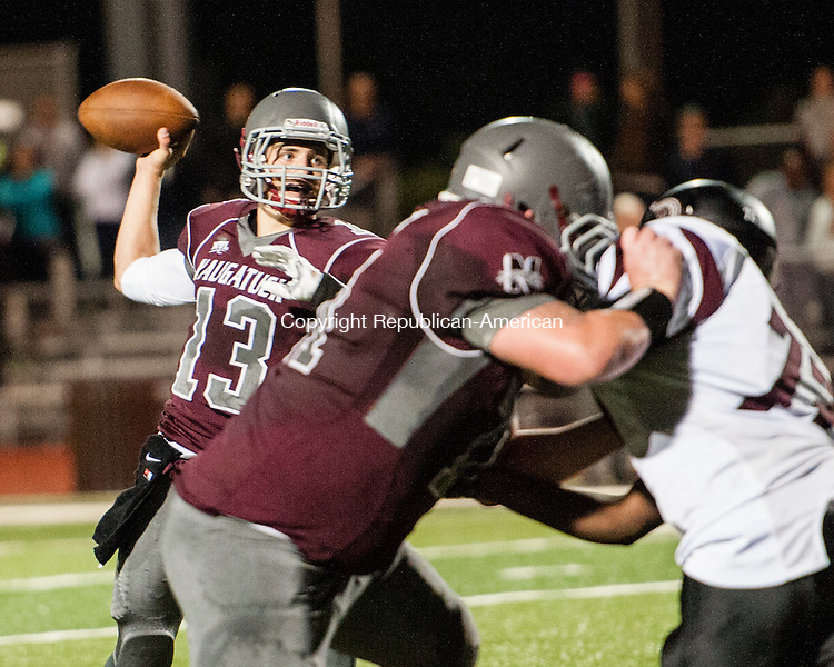 NAUGATUCK, CT-12 September 2014-091214EC17-  Naugatuck's Jason Bradley looks for an open teammate against Torrington Friday night in Naugatuck. Erin Covey Republican-American