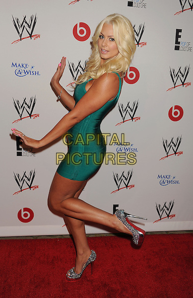 Maryse Ouellet<br /> WWE &amp; E! Entertainment's &quot;SuperStars For Hope&quot; supporting Make-A-Wish at The Beverly Hills Hotel in Beverly Hills, CA., USA.<br /> August 15th, 2013<br /> full length green dress side hands arms standing on one leg foot up <br /> CAP/ROT/TM<br /> &copy;Tony Michaels/Roth Stock/Capital Pictures