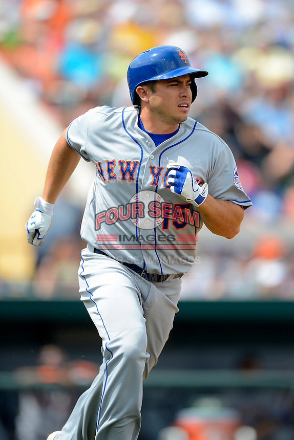 New York Mets designated hitter Travis d'Arnaud #15 during a Spring Training game against the Detroit Tigers at Joker Marchant Stadium on March 11, 2013 in Lakeland, Florida.  New York defeated Detroit 11-0.  (Mike Janes/Four Seam Images)