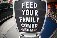 Feed your family combo sign at Hill Country Barbecue in New York on Sunday, May 27, 2012.  (© Frances M. Roberts