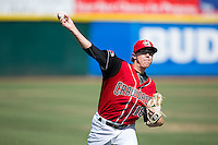Hickory Crawdads starting pitcher Matt Ball (18) warms up in the outfield prior to the game against the Delmarva Shorebirds at L.P. Frans Stadium on June 18, 2016 in Hickory, North Carolina.  The Crawdads defeated the Shorebirds 1-0 in game one of a double-header.  (Brian Westerholt/Four Seam Images)