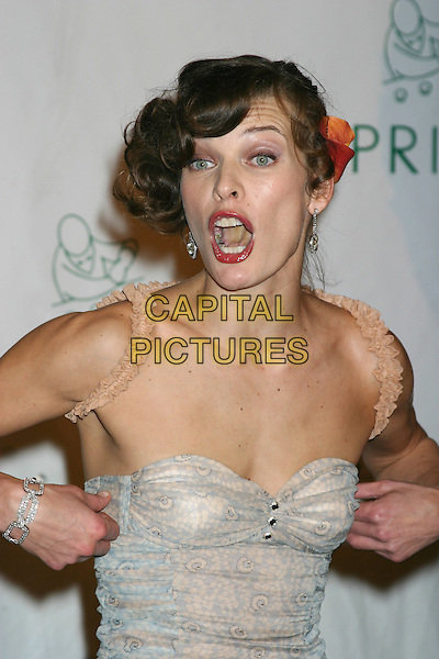 MILLA JOVOVICH.Royal Birthday Ball for Sean P. Diddy Combs - Inside Arrivals.Cipriani's, New York City, New York .November 4, 2004.headshot, portrait, pulling up top, gesture, funny face, cleavage, ruffles, yellow tongue, screaming, mouth open.www.capitalpictures.com.sales@capitalpictures.com.© Capital Pictures.com