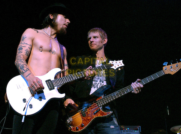 DAVE NAVARRO & CHRIS CHANEY.Perform live with Camp Freddy at the DKNY Jeans Vanity Fair Benefit Concert  for The Step Up Women's Network held at The Wiltern Theatre LG in Los Angeles, California, USA, October 23rd 2004..half length music gig on stage concert guitar topless bare chest tattooes tattoo nipple pierced piercing.Ref: DVS.www.capitalpictures.com.sales@capitalpictures.com.©Debbie VanStory/Capital Pictures .