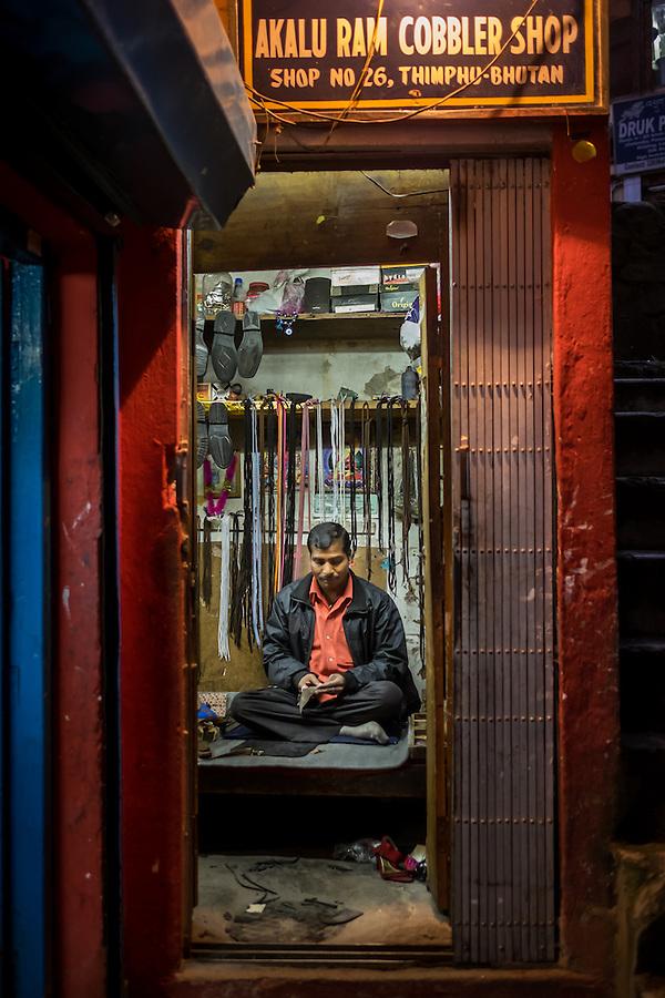 THIMPHU, BHUTAN - CIRCA OCTOBER 2014: Cobbler shop in Thimpu, Bhutan