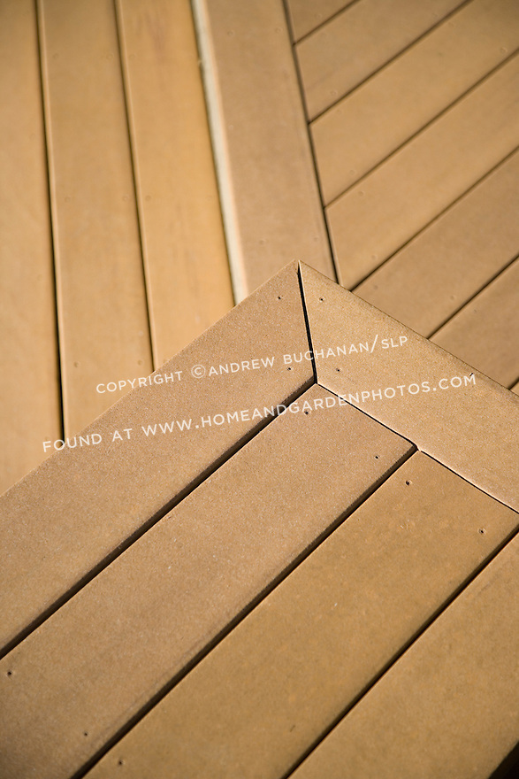 Detail of a corner of a bench seat constructed of Trex brand composite decking