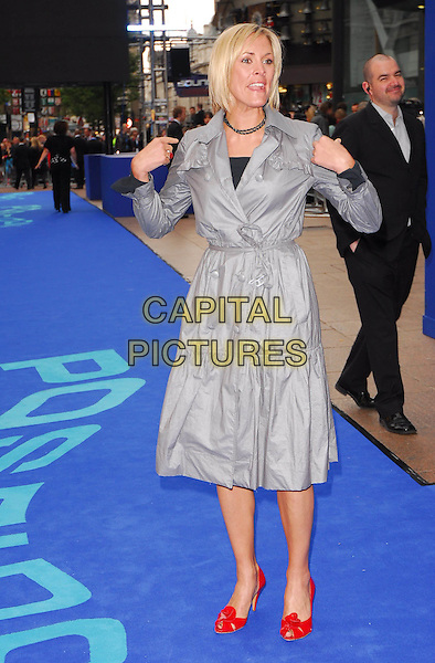 "JENNI FALCONNER.At the UK Film Premiere of ""Poseidon"", .Empire Leicester Square, London, .May 28th 2006..full length jenny grey dress coat red shoes flower blue carpet funny arms hands .Ref: CAN.www.capitalpictures.com.sales@capitalpictures.com.©Can Nguyen/Capital Pictures"