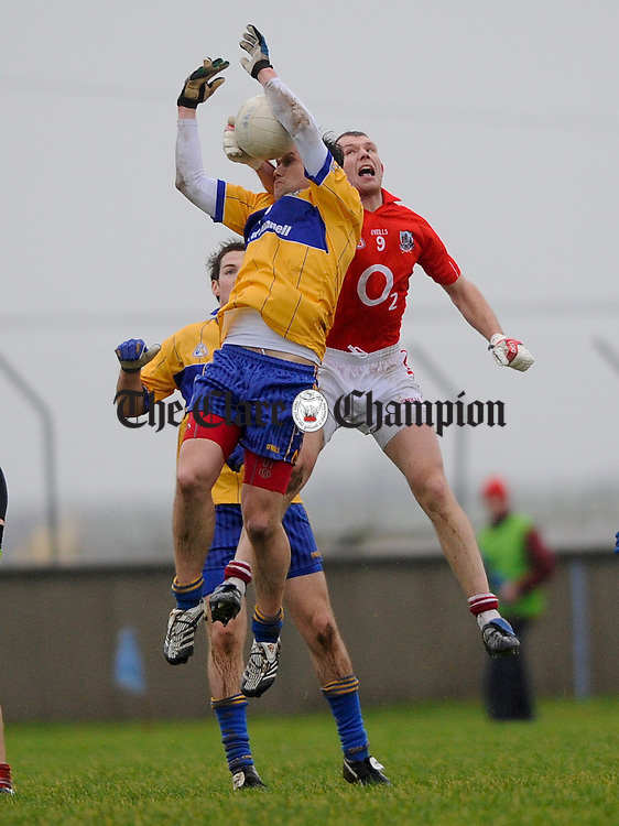 Clare's Peter O Dwyer and Cok's Alan O Connor contest a high ball during their Mc Grath Cup quarter final at Cooraclare. Photograph by John Kelly.