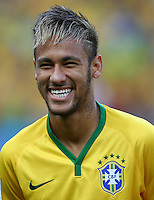 Neymar of Brazil smiles before kick off