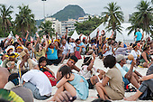 Indigenous people and others are assembling the human banner on Flamengo beach to protest about the construction of hydroelectric dams on Brazil's rivers. The People's Summit at the United Nations Conference on Sustainable Development (Rio+20), Rio de Janeiro, Brazil, 19th June 2012. Photo © Sue Cunningham.