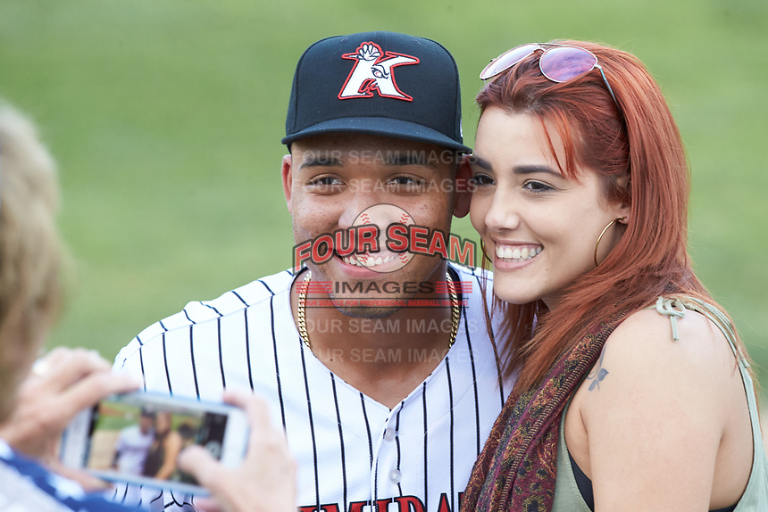 Luis Curbelo (left) poses for a photo with his girlfriend following his walk-off grand slam against the West Virginia Power at Kannapolis Intimidators Stadium on July 25, 2018 in Kannapolis, North Carolina. The Intimidators defeated the Power 6-2 in 8 innings in game one of a double-header. (Brian Westerholt/Four Seam Images)