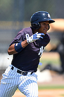 GCL Yankees 1 outfielder Leonardo Molina (18) runs to first during the first game of a doubleheader against the GCL Braves on July 1, 2014 at the Yankees Minor League Complex in Tampa, Florida.  GCL Yankees 1 defeated the GCL Braves 7-1.  (Mike Janes/Four Seam Images)