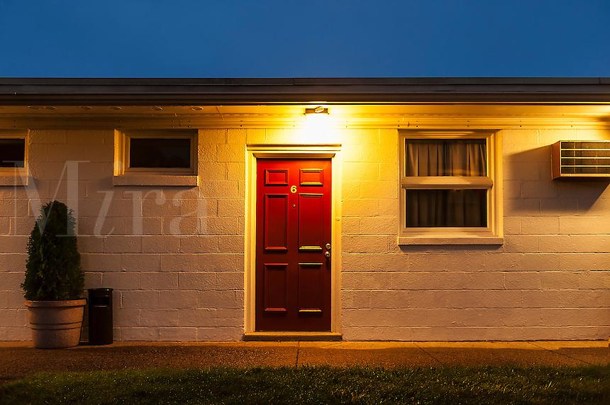 Motel room at night.