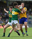 Gearoid Cahill Of Clare in action against Sean O'Leary and Michael Potts of Kerry during their Minor Munster final at Killarney.  Photograph by John Kelly.
