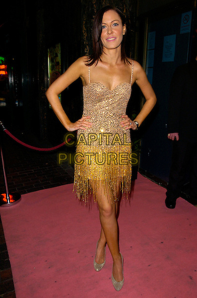 "LINZI STOPPARD.Attending ""A Night With Nick"" Gala Charity Event at Soho Revue Bar, London, England, November 26th 2007..full length gold beaded dress hands on hips Cavalli.CAP/CAN.©Can Nguyen/Capital Pictures"