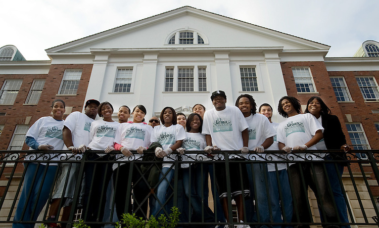 Urban Scholars Group Photo and Doing Community service work outside McCracken