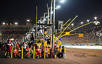 Apr 17, 2009; Avondale, AZ, USA; NASCAR Nationwide Series safety personnel watch from pit road during the Bashas Supermarkets 200 at Phoenix International Raceway. Mandatory Credit: Mark J. Rebilas-