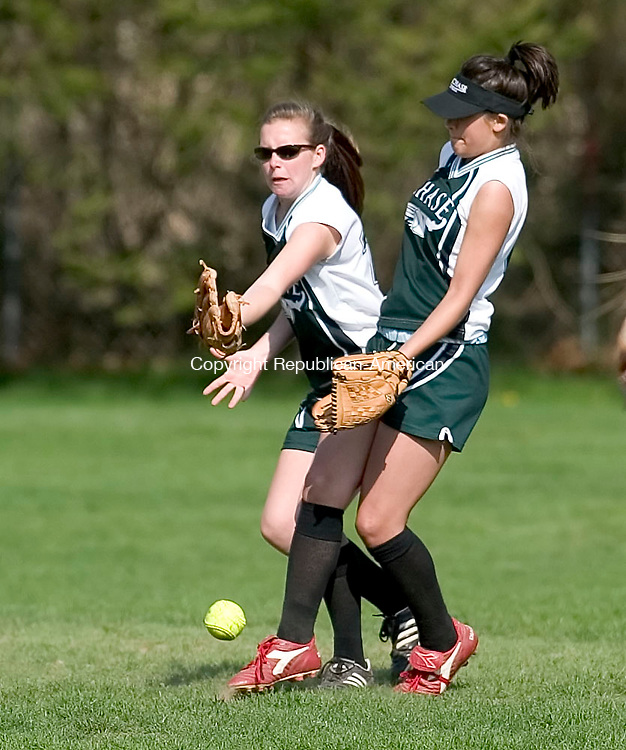 WATERBURY, CT- 26 APRIL 2008- 042608JT06- <br /> Chase's Amy Nasinka, left, and teammate Jenn Bosco collide as they both try unsuccessfully to catch a fly ball during Saturday's game against Millbrook at Chase.<br /> Josalee Thrift / Republican-American