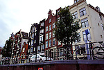 Tall narrow houses along a canal in Amsterdam.