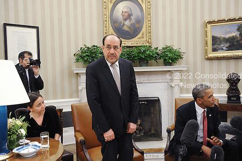 Prime Minister Nouri Al-Maliki of Iraq, left, looks on after a meeting with United States President Barack Obama in the Oval Office at the White House, Friday, November 1, 2013 in Washington, DC. <br /> Credit: Olivier Douliery / Pool via CNP
