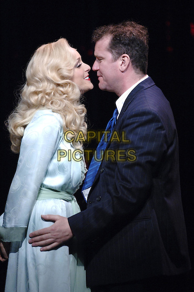 "JANE KRAKOWSKI & DOUGLAS HODGE.""Guys & Dolls"" production photocall,.Piccadilly Theatre, Denman Street, London, .May 31st 2005..Ref: PL.half length stage costume .www.capitalpictures.com.sales@capitalpictures.com.©Capital Pictures"