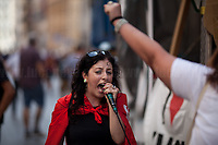 """Rome, 22/06/2019. Today, more than 15,000 people, including families and children, attended the demonstration called """"22 giugno Corteo per una città aperta, solidale e contro gli sgomberi: Roma non si chiude"""" (June 22, March for an open city, solidarity and against evictions: Rome cannot be shut down, 1.). The peaceful and colourful march was held from Piazza Vittorio Emanuele II to Via dei Fori Imperiali in central Rome. The demonstration was called to protest against the planned evictions of social centres and housing occupations linked to the endless Rome's 'housing crisis' and regeneration plans. The march was also called in support of Solidarity and Social Justice, against the rising of fascism, inequalities, social exclusion, racism, sexism, intolerance, """"authoritarian intimidations"""", and against the policies of the coalition Government League – Five Star Movement, especially the so-called """"Decreti Salvini / Decreti Sicurezza"""" (The first Decree is now Law of the Italian Republic, Legge 1° Dicembre 2018, n. 132, http://bit.do/eE7uo; Decree Law n. 53, 14 June 2019, http://bit.do/eV3iZ), made by the Interior Minister Matteo Salvini (League - Lega, http://bit.do/eV3EP & http://bit.do/eE7Ey), accused by protesters to be racist and restrictive of civil liberties. Last but not least, the march was held to show support and solidarity with migrants, refugees, Rom and Sinti Communities, minorities, with the NGOs trying to work and save lives in the Mediterranean, and to make heard the voices of the people who have paid the crisis with the rise of exploitation, discriminations, unemployment.<br /> <br /> Footnotes and Links:<br /> 1. http://bit.do/eV3jA"""