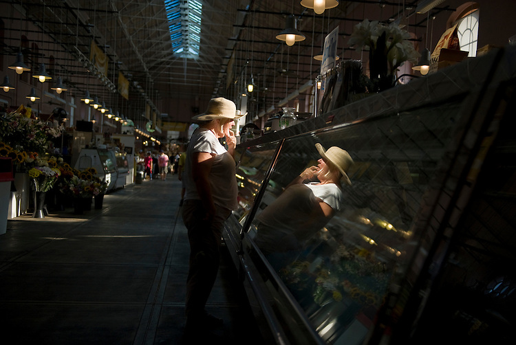 UNITED STATES - JULY 21:  A woman waits for service at an Eastern Market shop.  (Photo By Tom Williams/Roll Call)
