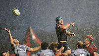 Stephan Lewies of Sharks cleans up after Steve Borthwick of Saracens mis-times his lineout jump during the Sanlam Private Investments Shield match between Saracens and the Cell C Sharks at Allianz Park on Saturday 25th January 2014 (Photo by Rob Munro)