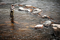 A woman nymph fishes on the Madison River in Bear Trap Canyon.